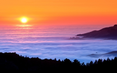 sunset-fog-over-sea-mountains.jpg